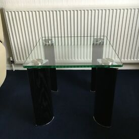 Glass coffee tables 1 square 1 rectangular with shelve both have black legs