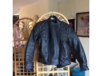Ladies never worn , black, size 12 fully padded leather jacket.