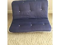 Wooden futon with quality mattress plus duvet with cover and spread. In new condition