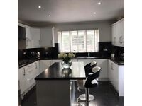 High gloss white fitted kitchen