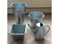 Galvanised steel pots and watering can
