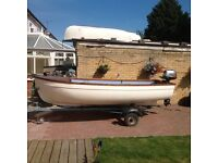GRP DINGHY,12 ft 5ft,on sprung road trailer,with outboard.