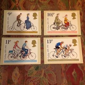 Set of 4 postcards depicting stamps to commemorate cycling