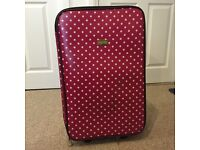 Pink/red and white polka dot suitcase
