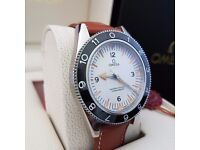 Boxed Omega SeaMaster 300 with white face black bezel & brown leather strap comes in Omega box & bag