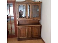 Solid wood Welsh dresser and matching table with 4 chairs. Table has extra leaves to expand