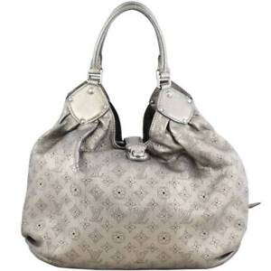 54a36d1665d3 Authentic Louis Vuitton Mahina XL Perforated Monogram