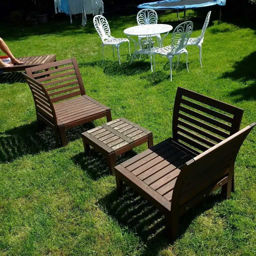 A Set Of Low Level Wooden Garden Or Patio Furniture Table Chairs And Sun Lounger