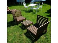 a set of low-level wooden garden or patio furniture table chairs and sun lounger can deliver