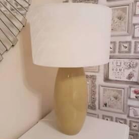 A stylish green and cream lamp