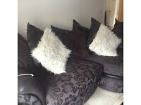 Three peice black couch with swirl chair