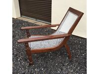 Indian Planters Chairs Two upholstered in leather and three just in rattan