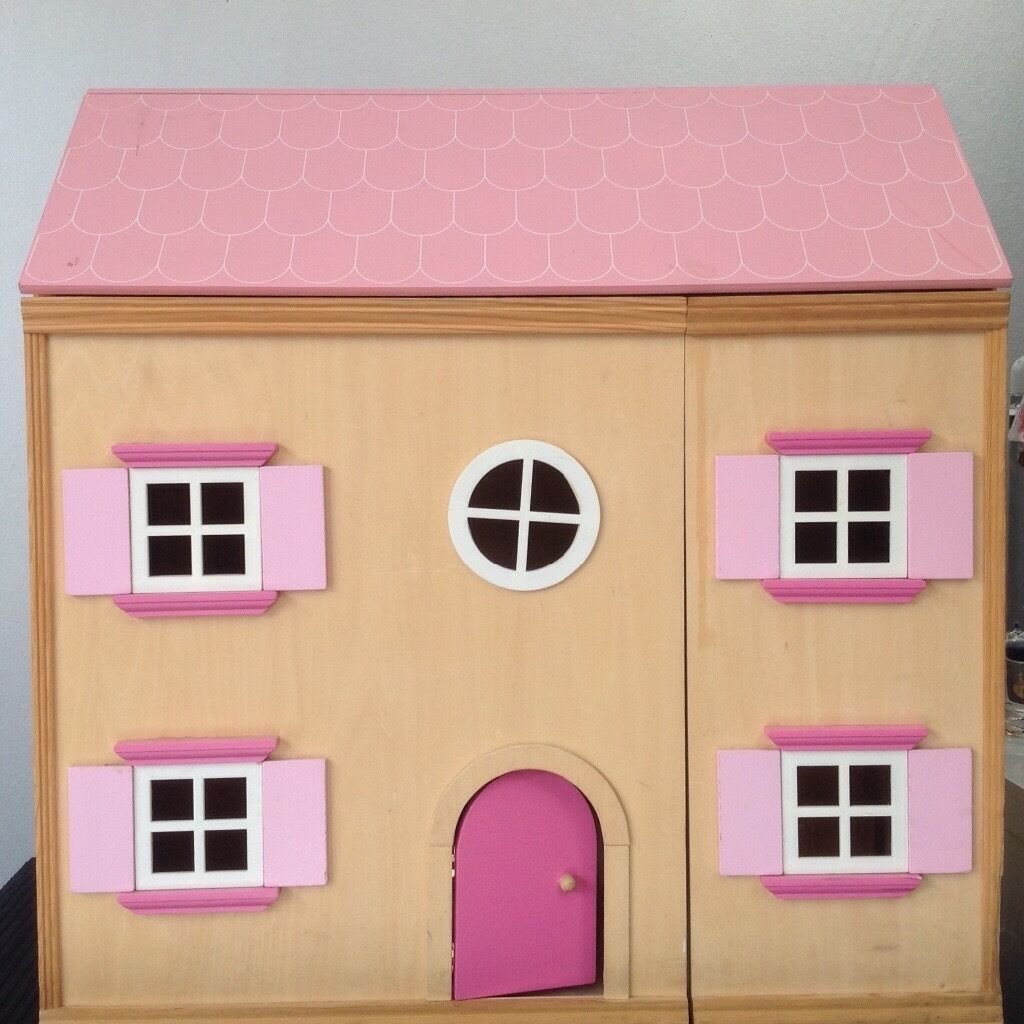 Wooden dolls house and furniture.