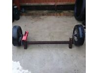 Trailer axle with towing hitch & wheels