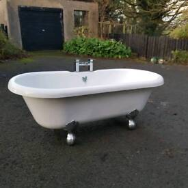 Traditional freestanding roll top bath with taps