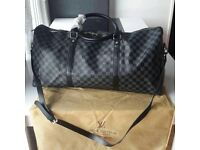 Louis Vuitton black duffle bag /keepall bag