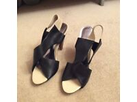 Size 7 beige and black women's sandals with 4 inch heels