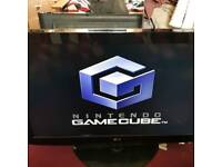 Gamecube with 12 boxed games and 2 controllers