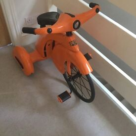 Orange old tricycle