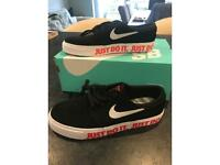 Boys Nike black and white suede trainers size 4