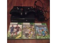 Xbox 360 with 2 wireless controllers and 3 games