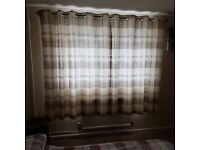 Lined biege check eyelet curtains