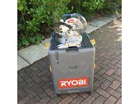 Ryobi 18 volt mitre saw within a wheeled tool trolley