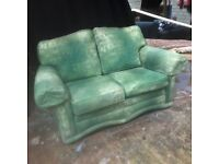 Green comfy two seater sofa