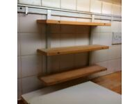 long kitchen under cabinet rail with hooks and shelves