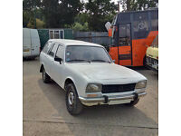 Left hand drive Peugeot 504 Break 2.3 GRD Renforce 7 seats.