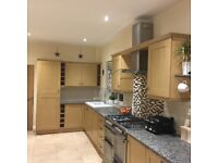 Pre-owned Howdens kitchen. Light oak units/doors and granite work tops.