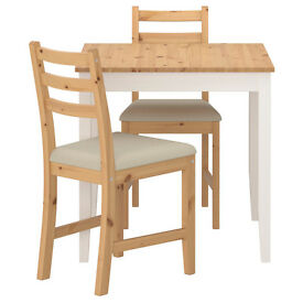 Small dinning table with 2 chairs. In perfect condition and ideal for a small space.