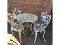 White cast iron table and 4 chairs