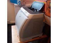 Hp color laserjet printer and cartridges.