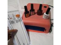 UV nail lamp, brushes and gel colors