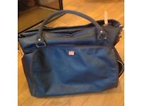 A used but in good condition navy blue PacaPod Mirano changing bag