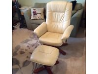 Cream leather reclining chairs and footstools