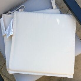Two seat pads for garden furniture. Cream with ties. Great condition hardly used.