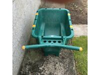 Solid plastic wheelbarrow