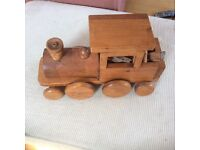 Large wooden train with wood