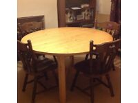 """4' 3"""" diameter Iowa dining table has some marks on surface"""