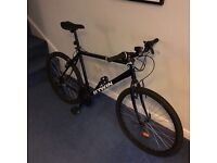 26 inches Mountain bike with Shimano 21 - used twice. Almost brand new