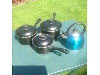 Various saucepans and a kettle for camping