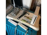 Wii console + Wii fit board