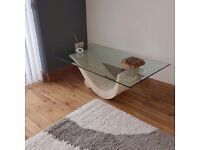 For sale modern glass topped coffee table with marble base