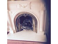 Cast Iron living flame fire ,Marble base and wooden surrond .
