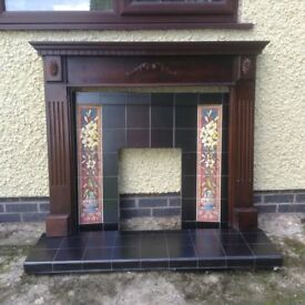 Fireplace with tiled hearth and wooden surround.