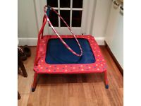 small kids folding trampoline or bouncer with railing and hoola hoop