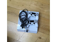 Sony PlayStation 4 Console (White) and two DualShock consoles.