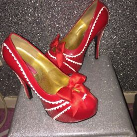 Women's red healed shoes